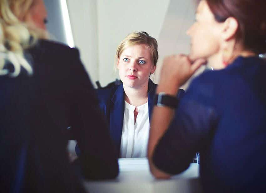 three-women-sitting-beside-table Accounting Services